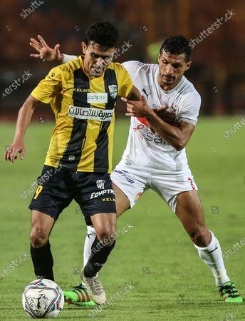 Zamalek player Tarek Hamed (R) in action against Al Mokaweloon player Mohamed Magli  during the Egyptian Premier League soccer match between Zamalek and Al Mokaweloon, in Cairo, Egypt, 27 August 2020.