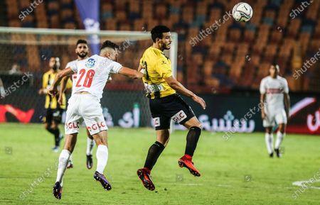 Zamalek player Tarek Hamed (up) in action against Al Mokaweloon playerShokry Naguib during the Egyptian Premier League soccer match between Zamalek and Al Mokaweloon, in Cairo, Egypt, 27 August 2020.