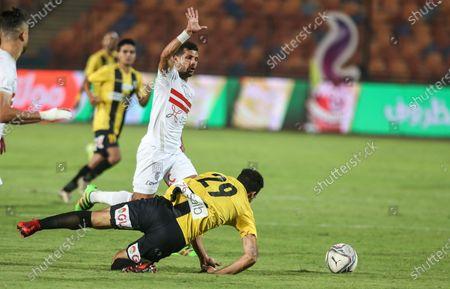 Zamalek player Tarek Hamed (up) in action against Al Mokaweloon player Shokry Naguib during the Egyptian Premier League soccer match between Zamalek and Al Mokaweloon, in Cairo, Egypt, 27 August 2020.