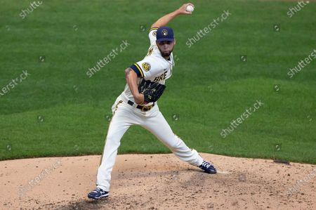 Milwaukee Brewers relief pitcher Alex Claudio #58 delivers a pitch in the Major League Baseball game between the Milwaukee Brewers and the Cincinnati Reds at Miller Park in Milwaukee, WI