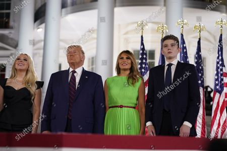 Tiffany Trump, United States President Donald J. Trump, first lady Melania Trump, Barron Trump watch the fireworks display after the President formally accepted the 2020 Republican presidential nomination during his Republican National Convention address from the South Lawn of the White House in Washington, DC.