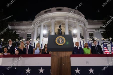 Jared Kushner, Ivanka Trump, Eric Trump, Lara Trump, Kimberly Guilfoyle, Donald Trump, Melania Trump, Barron Trump watch the fireworks display after United States President Donald J. Trump formally accepted the 2020 Republican presidential nomination during his Republican National Convention address from the South Lawn of the White House in Washington, DC.