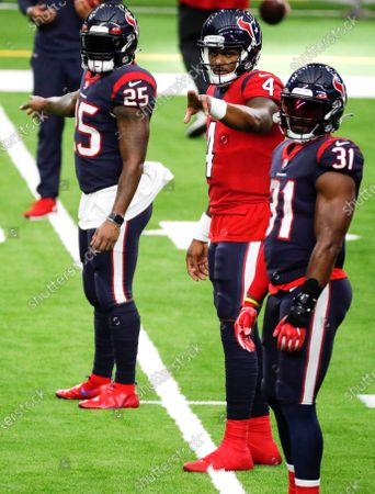 Houston Texans quarterback Deshaun Watson (4) calls out signals as he lines up with running backs Duke Johnson (25) and David Johnson (31) during NFL football training camp, in Houston