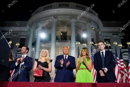 From left, Donald Trump Jr., Tiffany Trump, President Donald Trump, first lady Melania Trump and Barron Trump stand on the South Lawn of the White House on the fourth day of the Republican National Convention, in Washington