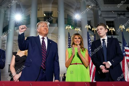 President Donald Trump, first lady Melania Trump and Barron Trump stand on the South Lawn of the White House on the fourth day of the Republican National Convention, in Washington