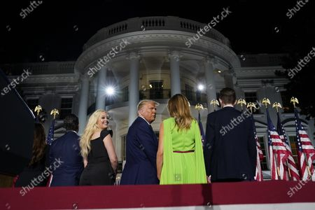 From left, Donald Trump Jr., Tiffany Trump, President Donald Trump, first lady Melania Trump and Barron Trump listen to Christopher Macho sing on the South Lawn of the White House on the fourth day of the Republican National Convention, in Washington