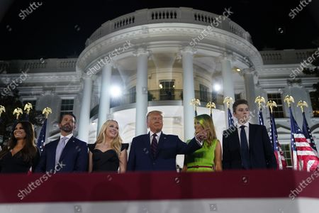 From left, Kimberly Guilfoyle, Donald Trump Jr., Tiffany Trump, President Donald Trump, first lady Melania Trump and Barron Trump stand on stage on the South Lawn of the White House on the fourth day of the Republican National Convention, in Washington