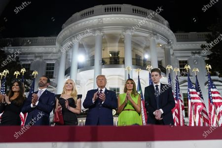 From left, Kimberly Guilfoyle, Donald Trump Jr., Tiffany Trump, President Donald Trump, first lady Melania Trump and Barron Trump stand on the South Lawn of the White House on the fourth day of the Republican National Convention, in Washington