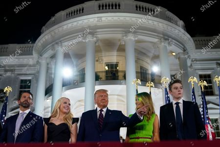 From left, Donald Trump Jr., Tiffany Trump, President Donald Trump, first lady Melania Trump and Barron Trump stand on stage on the South Lawn of the White House on the fourth day of the Republican National Convention, in Washington