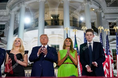 From left, Tiffany Trump, President Donald Trump, first lady Melania Trump and Barron Trump stand on stage on the South Lawn of the White House on the fourth day of the Republican National Convention, in Washington
