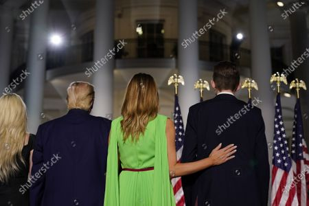 Stock Photo of (L-R) Tiffany Trump, US President Donald J. Trump, First Lady Melania Trump, and Barron Trump stand on stage during the closing night of the Republican National Convention, on the South Lawn of the White House, in Washington, DC, USA, 27 August 2020. Due to the coronavirus pandemic the Republican Party has moved to a televised format for its convention.