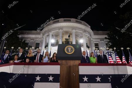 (L to R, top row) Senior Presidential Advisor Jared Kushner, Ivanka Trump, Eric Trump, Lara Trump, Kimberly Guilfoyle, US President Donald J. Trump, First Lady Melania Trump, and Barron Trump stand on stage during the closing night of the Republican National Convention, on the South Lawn of the White House, in Washington, DC, USA, 27 August 2020. Due to the coronavirus pandemic the Republican Party has moved to a televised format for its convention.