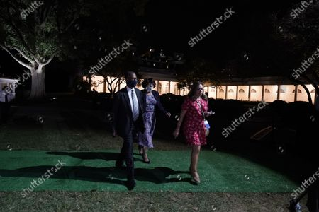United States Secretary of Housing and Urban Development Ben Carson (L) with his wife Candy Rustin (C) wear face masks during the closing night of the Republican National Convention, on the South Lawn of the White House, in Washington, DC, USA, 27 August 2020. Due to the coronavirus pandemic the Republican Party has moved to a televised format for its convention.