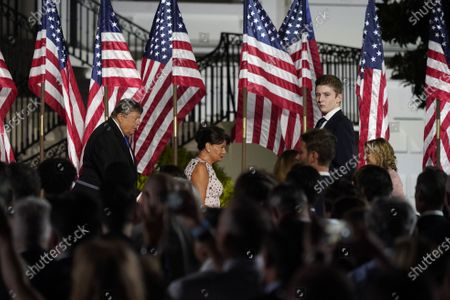 (L-R) Viktor Knavs, Amalija Knavs, and Barron Trump attend the closing night of the Republican National Convention, on the South Lawn of the White House, in Washington, DC, USA, 27 August 2020. Due to the coronavirus pandemic the Republican Party has moved to a televised format for its convention.