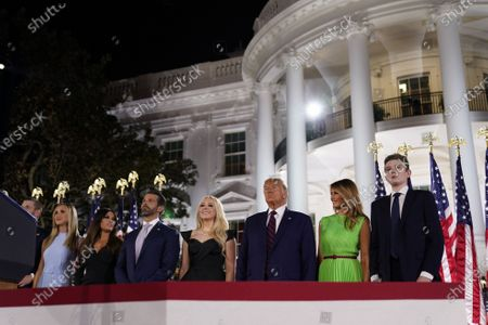 Eric Trump, Lara Trump, Kimberly Guilfoyle, Donald Trump, Melania Trump, Barron Trump watch the fireworks display after the President formally accepted the 2020 Republican presidential nomination during his Republican National Convention address from the South Lawn of the White House in Washington, DC.
