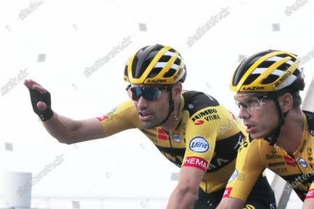 Netherland's Tom Dumoulin, left, and German Tony Martin speak as they ride during a training session, in Nice, southern France, ahead of upcoming Saturday's start of the race, . The Tour de France sets off shrouded in uncertainty and riding in the face of the coronavirus pandemic and mounting infections in France