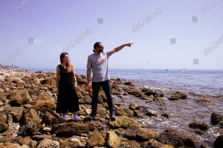 Stock Picture of Spanish documentary maker and director Paula Palacios (L) poses next to Operation Coordinator of the Open Arms vessel, Gerard Canals, at Los Banos del Carmen beach during the presentation of the documentary 'Cartas Mojadas' (lit. Wet letters), produced by Isabel Coixet, at Malaga's Film Festival in Malaga, Spain, 28 August 2020. The documentary narrates the story of migrants, how they leave their countries, why they flee from their homes how they run away crossing the sea and what happens to them when they reach Europe.