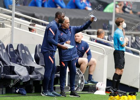 Tottenham Hotspur Manager Jose Mourinho giving instructions to Tottenham Hotspur First Team Assistant Manager Ledley King; Tottenham Hotspur Stadium, London, England; Pre-season football friendly; Tottenham Hotspur v Reading FC.
