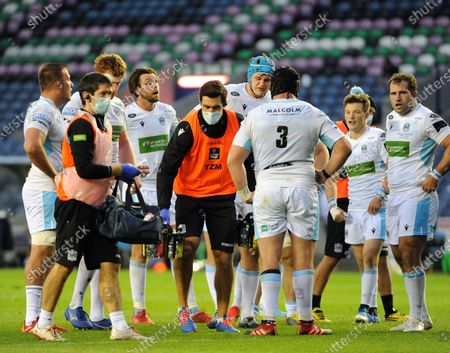 Kelly Brown - Glasgow Warriors assistant coach (centre with mask) brings on liquids for the players during a break in play.
