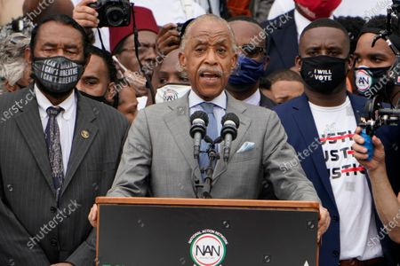 Rev. Al Sharpton, founder and president of National Action Network, speaks at the March on Washington, at the Lincoln Memorial in Washington. Ask left is Rep. Al Green, D-Texas