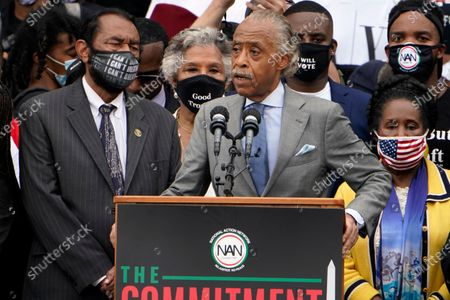 Rev. Al Sharpton, founder and president of National Action Network, speaks at the March on Washington, at the Lincoln Memorial in Washington, as Rep. Al Green, D-Texas, left, and Rep. Sheila Jackson Lee, D-Texas, listen