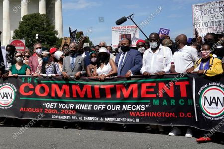 Rev. Al Sharpton, third from left, and Yolanda Renee King, granddaughter of Martin Luther King Jr., Arndrea Waters King, Martin Luther King, III, and Rep. Sheila Jackson Lee, D-Texas, far right, prepare to march from the Lincoln Memorial to the Martin Luther King Jr. Memorial during the March on Washington, in Washington