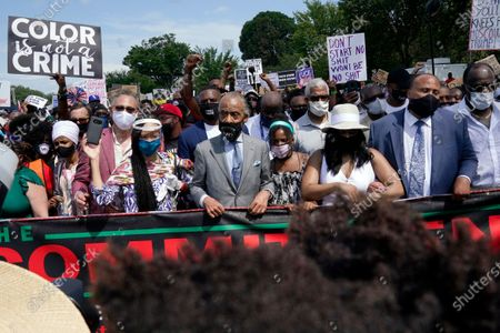 Rev. Al Sharpton, Yolanda Renee King, Arndrea Waters King and Martin Luther King, III prepare to march from the Lincoln Memorial to the Martin Luther King Jr. Memorial during the March on Washington, in Washington