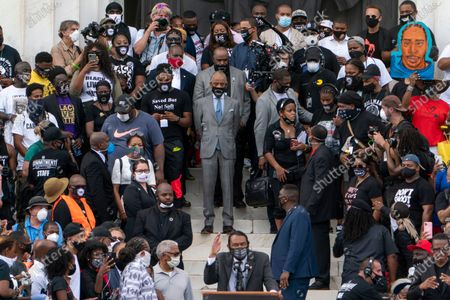 """Rep. Al Green, D-Texas, bottom center, introduces Rev. Al Sharpton, center, during the March on Washington, at the Lincoln Memorial in Washington, on the 57th anniversary of the Rev. Martin Luther King Jr.'s """"I Have A Dream"""" speech"""