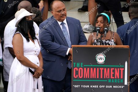 Yolanda Renee King, granddaughter of Martin Luther King Jr., speaks at the March on Washington, at the Lincoln Memorial in Washington. At left are her parents Arndrea Waters King and Martin Luther King, III