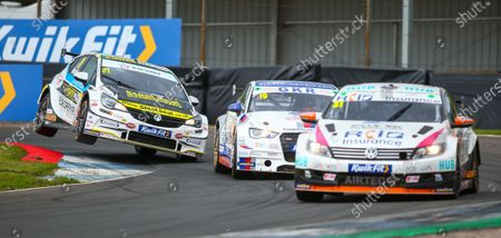 Mike Bushell puts pressure on Bobby Thomson and Jack Goff during qualifying; Knockhill Racing Circuit, Fife, Scotland; Kwik Fit British Touring Car Championship, Knockhill, Qualifying Day.