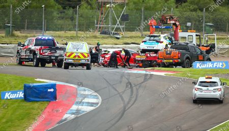 The track is cleared after the collision with Ollie Jackson and Mike Bushell in round 12 of the BTCC; Knockhill Racing Circuit, Fife, Scotland; Kwik Fit British Touring Car Championship, Knockhill, Race Day.