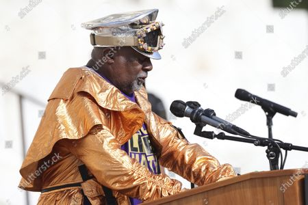 """Musician George Clinton speaks as demonstrators gather at the Lincoln Memorial for the March on Washington, in Washington, on the 57th anniversary of the Rev. Martin Luther King Jr.'s """"I Have A Dream"""" speech"""