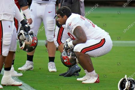 Tampa Bay Buccaneers first-round draft pick, offensive tackle Tristan Wirfs, stretches during an NFL football training camp practice, in Tampa, Fla