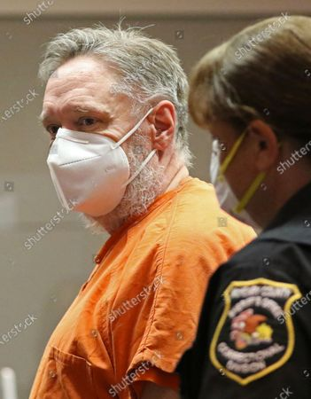 Andrew Freund is led out of court for a trial status appearance at the Michael J. Sullivan Judicial Center, formerly known as the McHenry County Courthouse, on in Woodstock, Ill. Freund is accused of multiple charges in the April 2019 death of son AJ Freund, 5. Freund will begin trial on the morning of Dec. 9, and is expected to last three days