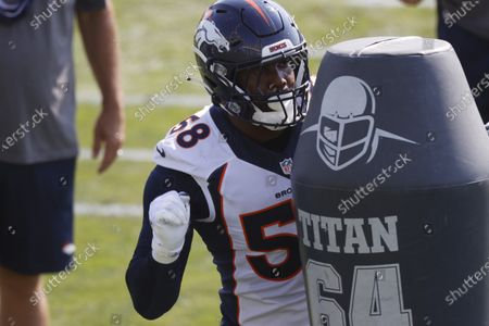 Denver Broncos linebacker Von Miller takes part in drills during an NFL football practice at the team's headquarters in Englewood, Colo. One of the NFL's biggest stars, Miller was among many players who had to balance playing or opting out for the season
