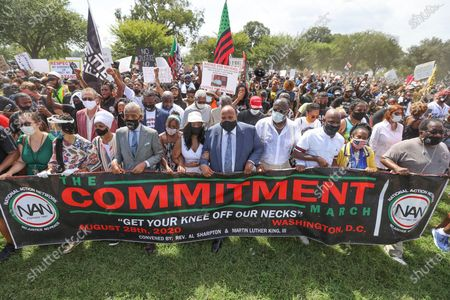 """March organizers and leaders including Rev. Al Sharpton, Martin Luther King III, eldest son of Martin Luther King Jr., and his wife Arndrea Waters King begin the """"Get Your Knee Off Our Necks"""" Commitment March on Washington 2020 following a gathering at the Lincoln Memorial in Washington, DC, USA 28 August 2020. The March on Washington comes on the 57th anniversary of Dr. Martin Luther King's historic march, when he delivered his 'I Have a Dream' speech."""