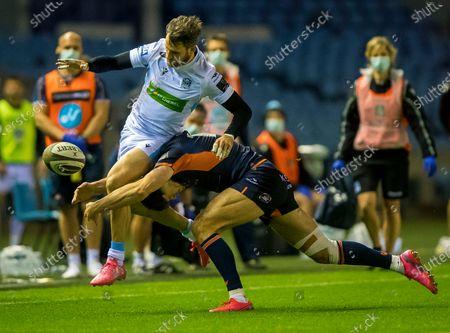 Glasgow Warriors vs Edinburgh. Glasgow's Tommy Seymour is tackled by Blair Kinghorn of Edinburgh