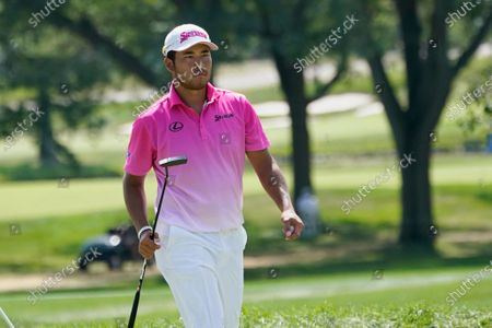 Hideki Matsuyama walks off the first hole after making par during the second round of the BMW Championship golf tournament, at Olympia Fields Country Club in Olympia Fields, Ill