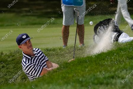 Billy Horschel hits from a bunker on the first hole during the second round of the BMW Championship golf tournament, at Olympia Fields Country Club in Olympia Fields, Ill