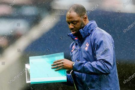 Ledley King Tottenham Hotspur Assistant First Team Coach reads through his notes