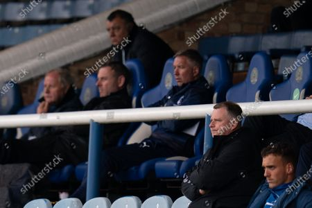 Coventry City Manager Mark Robins sits in the stands with Peterborough United Manager Darren Ferguson, Peterborough United Chairman Darragh MacAnthony and Director of Football Barry Fry