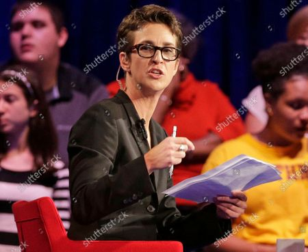 """Stock Image of MSNBC's Rachel Maddow speaks during a Democratic presidential candidate forum at Winthrop University in Rock Hill, S.C. MSNBC mounted an aggressive on-air fact-checking operation during the Republican national convention, often breaking in to its telecast to question some of the claims made from the stage. Both Maddow and CNN's Daniel Dale aired """"lightning-round"""" fact-checks following President Donald Trump's acceptance speech on Thursday night. The frequency of pre-taped speeches enabled MSNBC to call in experts to help with its fact-checking"""