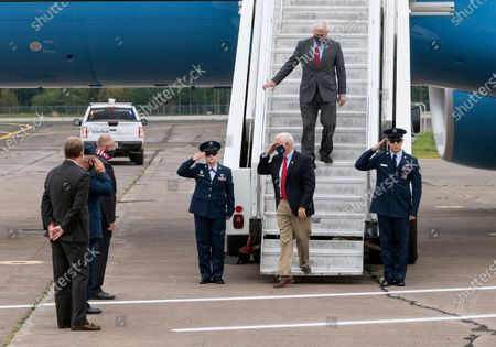 Rep. Tom Emmer, R-Minn., follows Vice President Mike Pence as Pence salutes, from left to right, Rep. Jason Lewis, R-Minn., Colonel Chris Blomquist, and Rep. Pete Stauber, R-Minn., after arriving at Duluth International Airport for a campaign stop, in Duluth, Minn