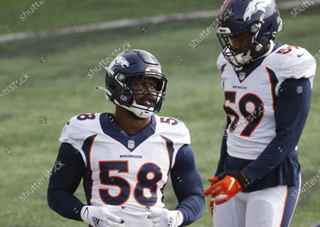 Denver Broncos linebackers Von Miller, front, and Malik Reed take part in drills during an NFL football practice, in Englewood, Colo
