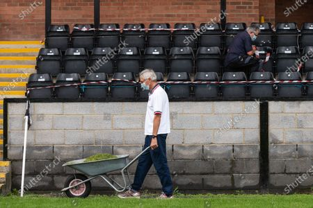 Volunteer groundsman Peter Robinson and maintenance volunteer John Harper tape off seating during preparations ahead of phase two of crowds being welcomed back into sporting events at The Raymond McEnhill Stadium in Salisbury, Wilts.  Inline with the governments easing of lockdown restrictions, Salisbury Football Club are preparing to welcome back 30% of their fans as of this Monday, August 31st which will be around 600.   Salisbury FC play in Southern League Premier Division South, or step 3 of the non-league football ladder.