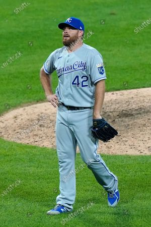 Kansas City Royals relief pitcher Ian Kennedy reacts after Chicago White Sox's Yasmani Grandal hit a winning solo home run during the ninth inning of a baseball game in Chicago