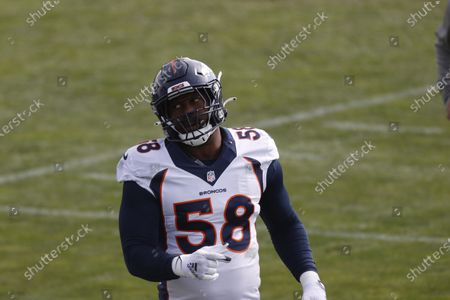 Denver Broncos linebacker Von Miller (58) takes part in drills during an NFL football practice, in Englewood, Colo