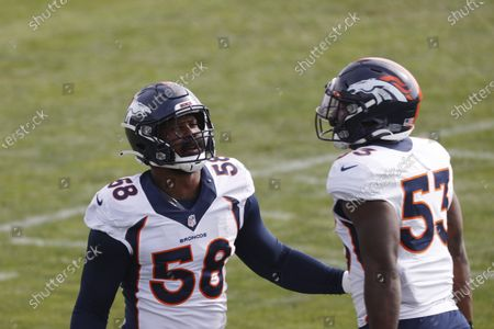 Denver Broncos linebacker Von Miller (58) takes part in drills with Denver Broncos linebacker Malik Carney (53) during an NFL football practice, in Englewood, Colo