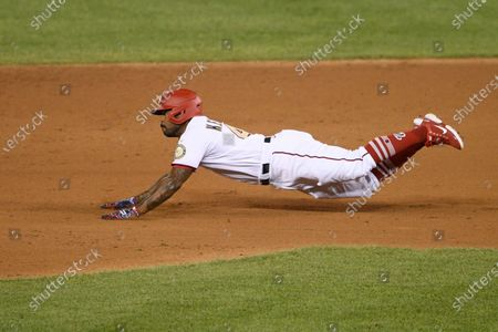 Washington Nationals' Howie Kendrick slides to second with a double during a baseball game against the Philadelphia Phillies, in Washington. The Phillies won 3-2