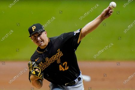 Pittsburgh Pirates starting pitcher Derek Holland throws during the first inning of a baseball game against the Milwaukee Brewers, in Milwaukee